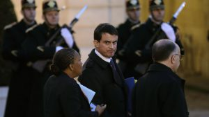 French Prime Minister Valls, Justice minister Taubira and Interior minister Cazeneuve speak together after a meeting at the Elysee Palace in Paris