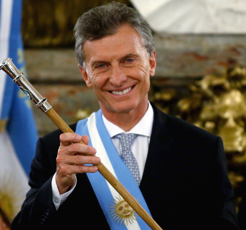 Argentina's President Mauricio Macri holds the symbolic leader's staff after being sworn-in as president at Casa Rosada Presidential Palace in Buenos Aires