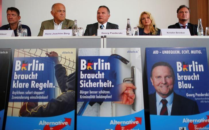 Padzerski, top candidate of the anti-immigration party AfD for the Berlin state elections, attends a news conference in Berlin
