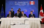 Canadian Prime Minister Justin Trudeau, second left, sits with, from left, European Commission President Jean-Claude Juncker, European Council President Donald Tusk and Slovakian Prime Minister Robert Fico as they sign the Comprehensive Economic and Trade Agreement (CETA) during an EU-Canada summit at the European Council building in Brussels, Sunday, Oct. 30, 2016.(Francois Lenoir/Pool Photo via AP)