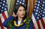 FILE - This Jan. 3, 2013 file photo shows Rep. Tulsi Gabbard, D-Hawaii, waiting for a photo with House Speaker John Boehner, of Ohio, on Capitol Hill in Washington. Gabbard is the first Hindu elected to Congress. Rep. Ami Bera of California, also a Democrat, is the third Indian-American to serve in the House. Gabbard, however, isn't from India, where Hinduism originated and to which the vast majority of its adherents have ethnic ties. (AP Photo/J. Scott Applewhite, File)