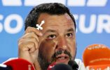 Italian Deputy Prime Minister and leader of far-right League party Matteo Salvini holds a crucifix as he speaks during his European Parliament election night event in Milan, Italy, May 27, 2019. REUTERS/Alessandro Garofalo