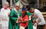 Indigenous peoples, some with their faces painted and wearing feathered headdresses, stand by  Pope Francis as he celebrates an opening Mass for the Amazon synod, in St. Peter's Basilica, at the Vatican, Sunday, Oct. 6, 2019. Pope Francis is opening a divisive meeting on preserving the Amazon and ministering to its indigenous peoples, as he fends off attacks from conservatives who are opposed to his ecological agenda. (AP Photo/Andrew Medichini)